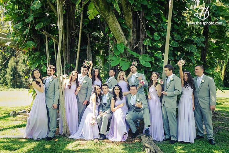 Bridal party taking photos at the tree