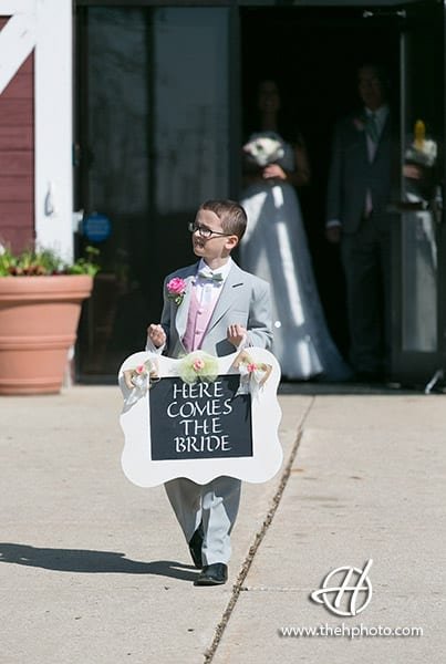 groom's nephew carrying the sign