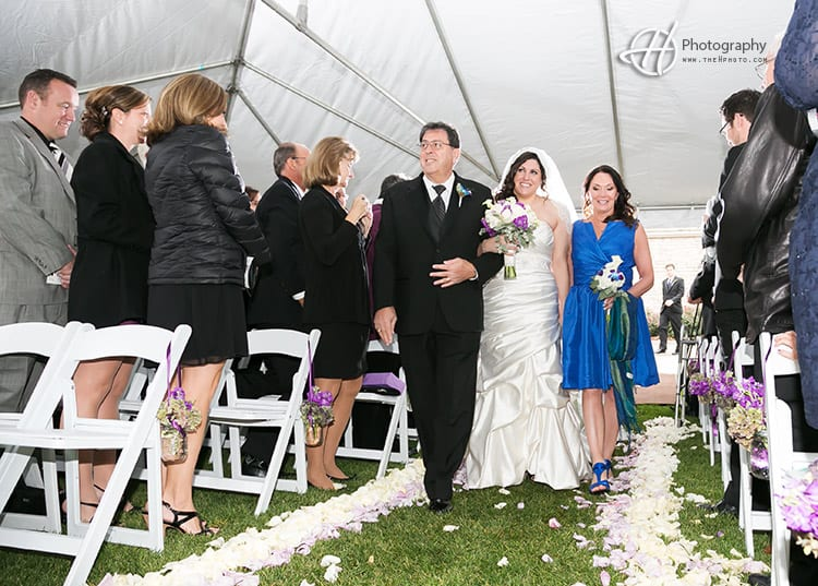 bride and parent coming to ceremony