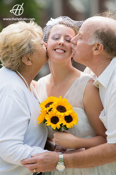 parents-kissing-the-bride
