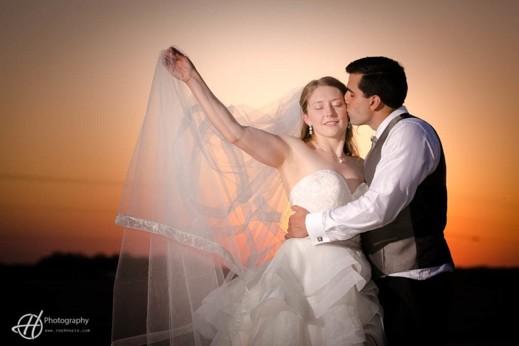 wedding portrait in sunset at OVer the Vine