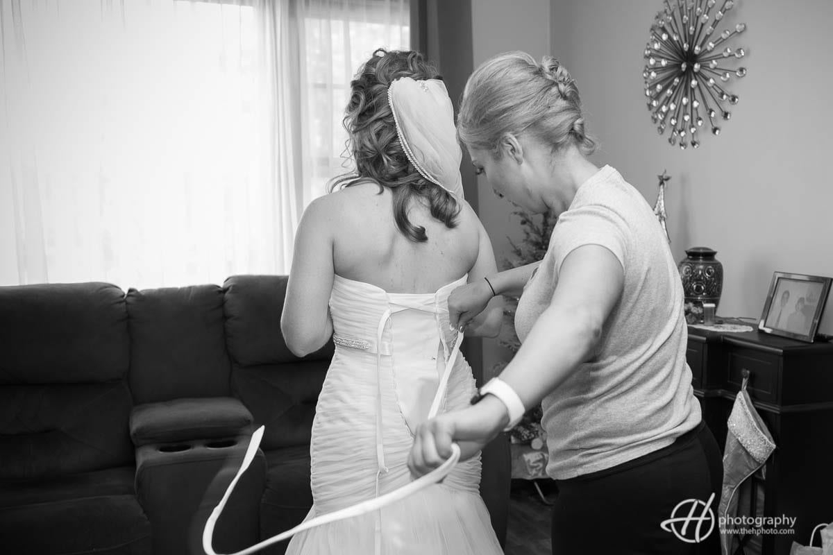 Maid of honor helping the bride.