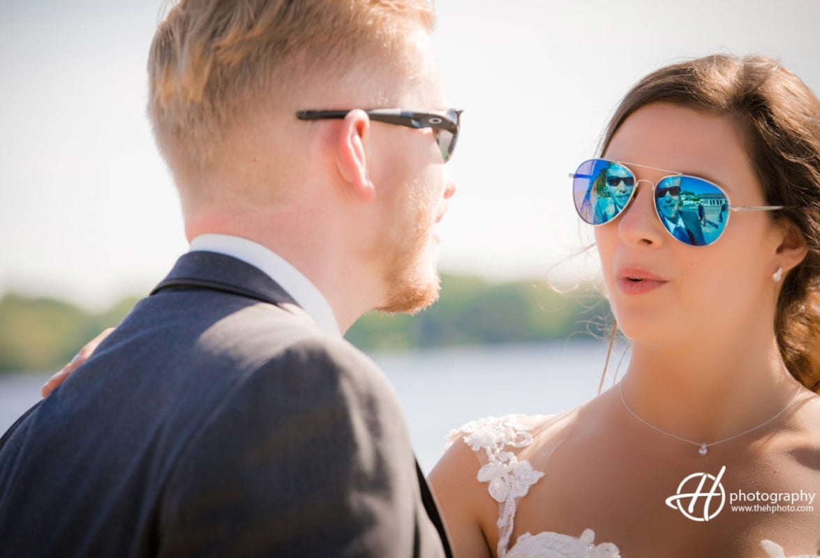groom reflected in bride's glasses