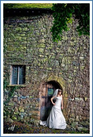 bride-posing-at-wall.jpg
